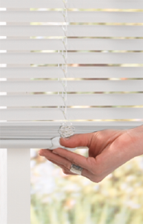 image showing a hand easily lifting/tilting a white cordless vinyl mini blind