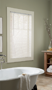 Room scene with white wand tilt mini blinds in a bathroom