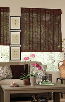 Vignette showing fruitwood matchstick rollup (indoor/outdoor) shades in a three-season patio